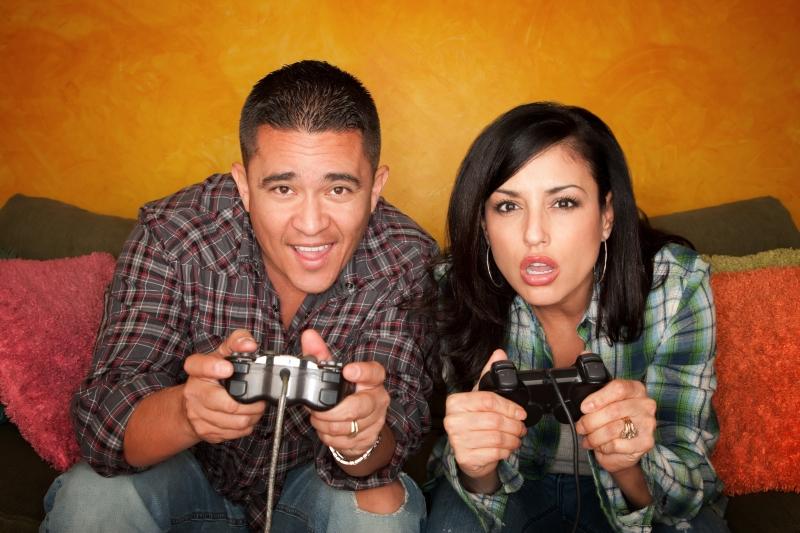 1172877-hispanic-couple-playing-video-game